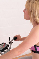 Young woman on her exercise bike