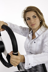A Blonde Teenage Girl With A Steering Wheel