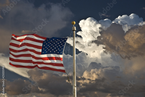 USA flag dark sky and clouds