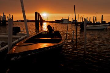 Sunrise shining behind a fishing boat in the Chesapeake Bay.