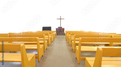 Church pews before cross and altar