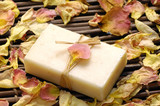 rose withered petals and soap on bamboo mat poster