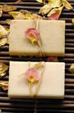 Soap and rose withered petals on bamboo mat poster