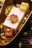Spa setting- bowl of withered rose ,soap and candle poster
