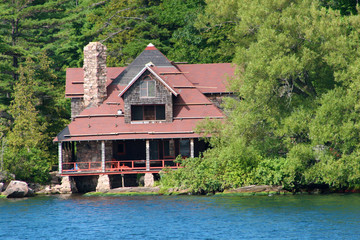 Closeup of a large cabin on a lake