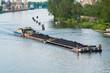 Leinwanddruck Bild - coal barge sailing on the river