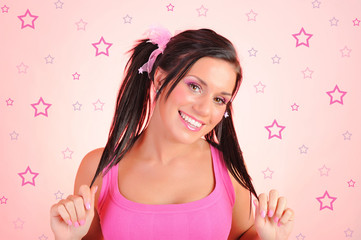 Beautiful happy woman with funny dual pony tails hairstyle. pink