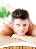 Portrait of a handsome man having a back massage