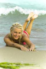 Beautiful young woman on a seashore
