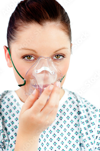 Diseased young woman with an oxygen mask looking at the camera