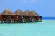 Maldives. .Villa on piles on water .