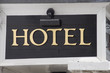 Hotel sign in gold