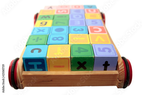 childrens play letter blocks in cart with clipping path