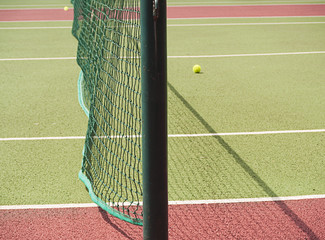 Close-up of tennis net with balls