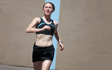 Woman running for fitness and health