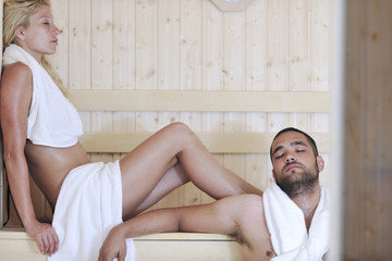happy young couple in sauna
