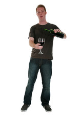a young man pours and enjoys a glass of red wine