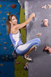 young, athletic girl climbing