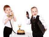 Children in business suit with telephone.