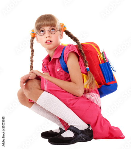 Scared sitting schoolchild  in eyeglasses.