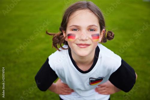 Leinwanddruck Bild Mädchen im Deutschland-Trikot