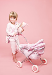 Young girl with baby stroller