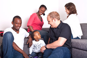 Young group of multiracial friends - two young families enjoying