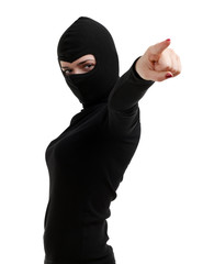 pointing female thief in black clothes and balaclava