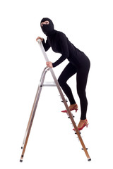 thief in balaclava entering on ladder