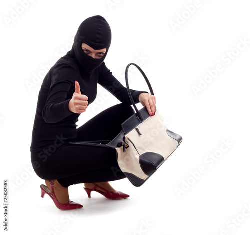 female thief  with stolen bag, thumb up.