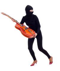 female thief in black balaclava with electric guitar