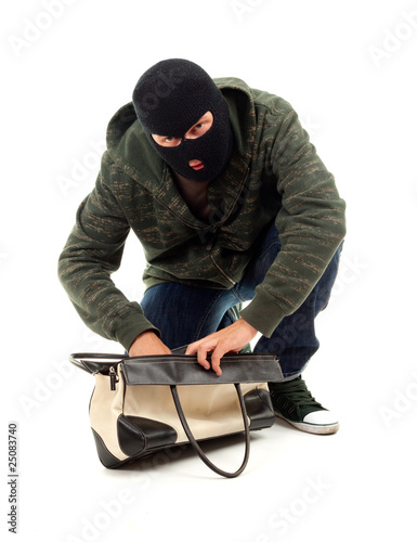 thief in black balaclava with stolen bag