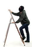 thief in black balaclava entering on ladder