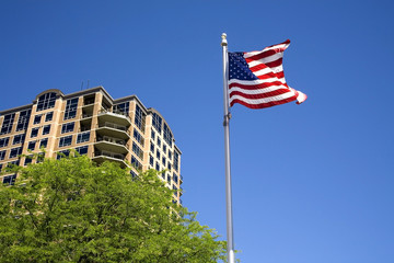 US flag by a building.