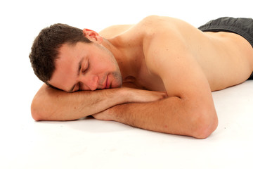 nude young man sleeping on the floor