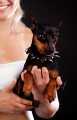 Womnan holding her dog
