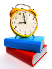 Alarm clock on blue and red books.