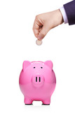 Hand inserting coin into piggybank isolated on white background poster