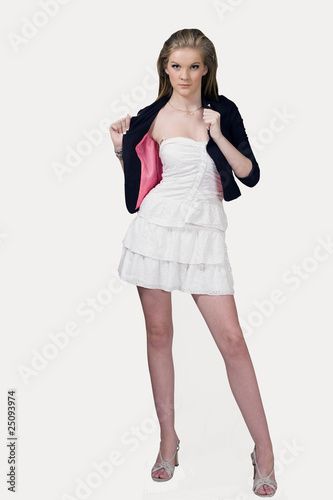 Fashion model on runway, on white background