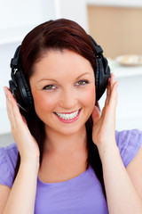Smiling pretty woman listen to music with headphones