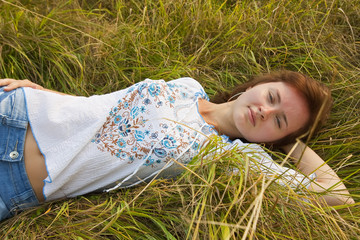 girl in white on grass meadow