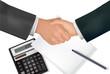 Handshake over paper with pen and calculator. Vector.
