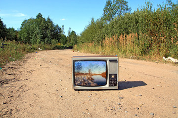 old television set on road