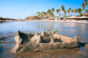 Sand castel on  beautiful tropical Vagator beach
