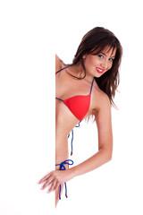 Bikini babe peeping from behind the sign board