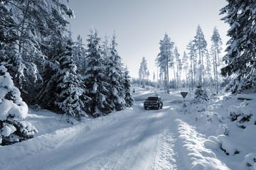 suv, car on snowy winter-road