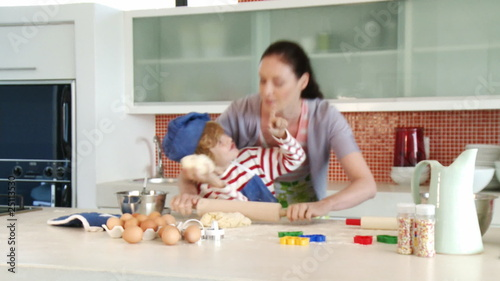 mother and son playing in the kitchen