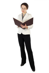 young attractive woman in business dress standing and reading