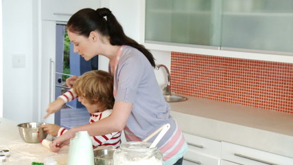beautiful mother cooking with her son