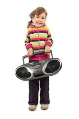 little girl holding tape recorder and smiling, full body
